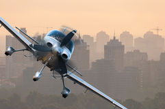 Aircraft traveling over city buildings and high-rise skyscrapers. Concept of privat airline travel business and civil. Aircrafts Stock Image