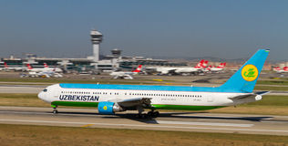 Aircraft. Uzbekistan Airways Boeing 767-33P/ER accelerate to takeoff at Ataturk Airport on May 26, 2013 in Istanbul, Turkey. UA is the national airline of stock photo