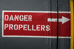 Aircraft Warning Sign. Detail of a danger sign warning of propellers on an old aircraft Stock Image