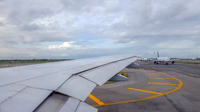 Aircraft were queuing to fly up. Bangkok,Thailand-Aug 4,2016:The view from the window of the aircraft were queuing to fly up at the Suvarnabhumi airport Royalty Free Stock Photography