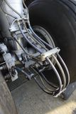 Aircraft wheels and brakes on the undercarriage of an airplane.  Royalty Free Stock Photography