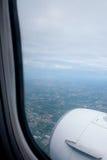 Aircraft window onto jet engine Royalty Free Stock Photos