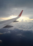 Aircraft window see clouds and sky onto jet engine Royalty Free Stock Photo