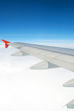 Aircraft wing. View of a flying wing aircraft - above the clouds Royalty Free Stock Photo