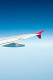 Aircraft wing. Some component of plane on during flying high above sky Royalty Free Stock Images