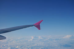 Aircraft wing. Flying high above the clouds Royalty Free Stock Image