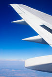 Aircraft wing. Flying high above the land Royalty Free Stock Images