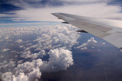 Aircraft Wing. An aircraft wing over bunches of fluffy clouds Royalty Free Stock Photography