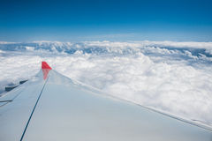Aircraft wing above clouds Royalty Free Stock Photos