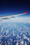 Aircraft Wing. Above clouds, looking outside the flight royalty free stock photos