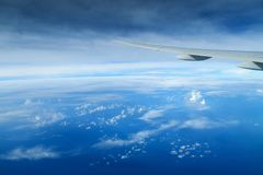 Aircraft wing above the clouds, view from the airplane window Stock Image