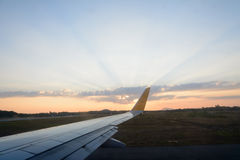 Aircraft wing against with beautiful sky with sun rays Royalty Free Stock Photos