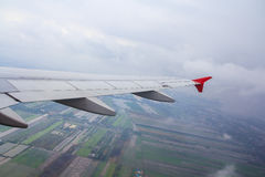 Aircraft wing in the air Stock Images