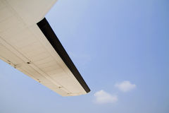Aircraft wing and blue sky Stock Photo