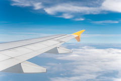 Aircraft wing with blue sky Stock Image