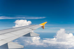 Aircraft wing with blue sky Royalty Free Stock Photo