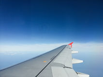 Aircraft wing with blue sky background Royalty Free Stock Photography