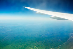 Aircraft wing on the blue sky background Royalty Free Stock Photo