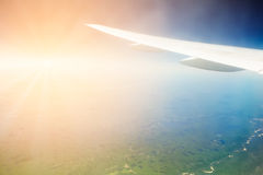 Aircraft wing on the blue sky background Royalty Free Stock Image