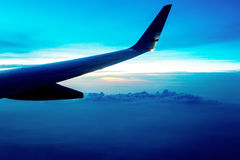 Aircraft wing on blue sky Stock Photos