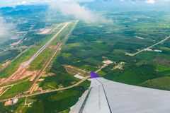Aircraft wing close-up and green fields and forest landscape fro. M the window royalty free stock images