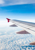 Aircraft Wing on cloud and blue sky Royalty Free Stock Image