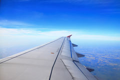Aircraft wing, cloud and clear sky Royalty Free Stock Photo
