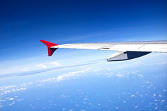 Aircraft wing on the clouds Stock Photography