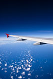 Aircraft wing on the clouds Royalty Free Stock Photo
