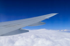 Aircraft wing on the clouds Stock Photos