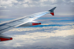 Aircraft wing on the clouds,flying background Stock Photography