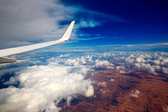 Aircraft wing in a cloudy stormy clouds sky Stock Images