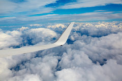 Aircraft wing in a cloudy stormy clouds sky Stock Photo