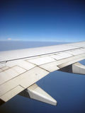 Aircraft wing in flight Stock Photography