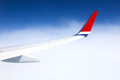 Aircraft wing during flight. Side view of the wing of an aircraft during flight Royalty Free Stock Image