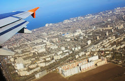 Aircraft wing in flight, view from the window of the plane flyin royalty free stock image