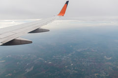 Aircraft wing flying on cloudscape Stock Images