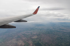Aircraft wing flying on cloudscape Royalty Free Stock Images