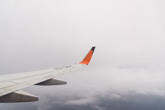 Aircraft wing flying on cloudscape Royalty Free Stock Photography