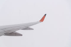 Aircraft wing flying on cloudscape Stock Photography