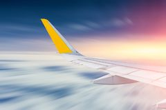 Aircraft wing flying fast in the sky stock photo