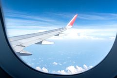 Aircraft Wing Look at view with cloud sky stock photos