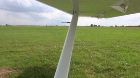 Aircraft wing in motion on airfield stock video footage