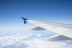 Free Aircraft Wing On Beautiful Blue Sky And Cloud Background In Altitude During Flight. Wing Of An Airplane Looking From The Window Royalty Free Stock Photography - 207706137