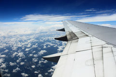 Aircraft Wing Over Clouds Stock Images