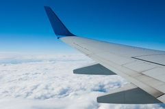 Aircraft wing over the clouds Royalty Free Stock Image