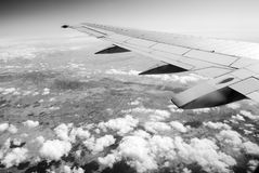Aircraft wing over land. Black and white image of aircraft wing over land Stock Images