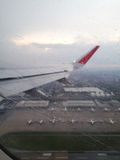 Aircraft wing see airport and plane with raindrop Stock Photography