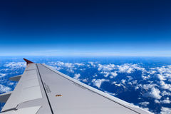 Aircraft wing on the sky Stock Photos