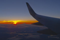 Aircraft wing at sunset Stock Photos
